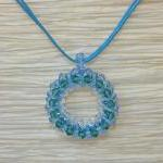 Holiday Jewelry. Sky. Round pendant..