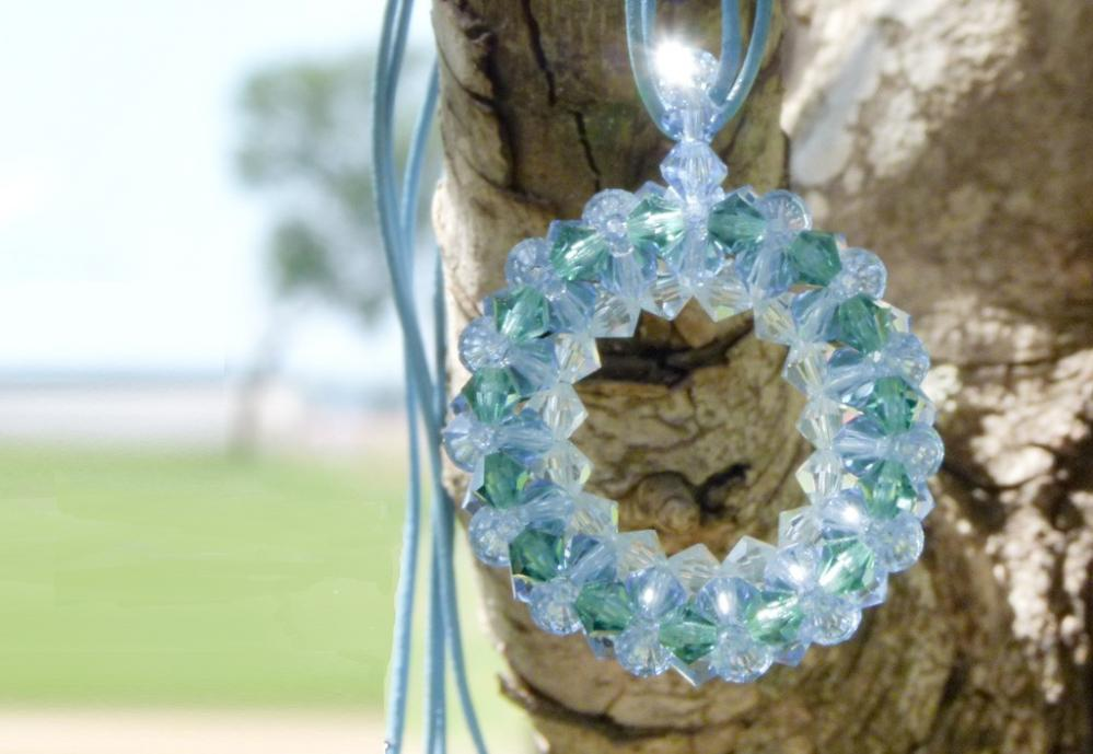 Holiday Jewelry. Sky. Round pendant Swarovski Crystal Bead Necklace Leather cord. Made to order