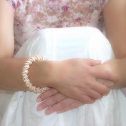Wedding Pearl white golden peach Cellini spiral. Beaded bangle bracelet. Bridesmade party